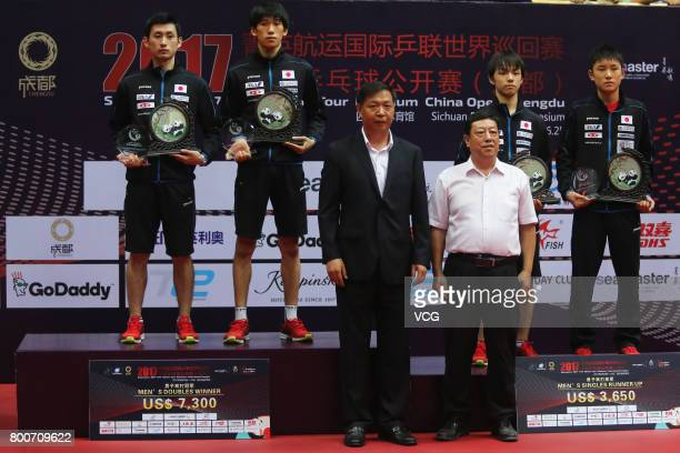 Winner Jin Ueda and Maharu Yoshimura of Japan and runnerup Koki Niwa and Tomokazu Harimoto of Japan attend the award ceremony after Men's doubles...