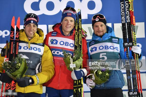 Winner Johannes Hoesflot Klaebo of Norway second placed Italy's Federico Pellegrino and third placed Renaud Jay of France pose on the podium after...