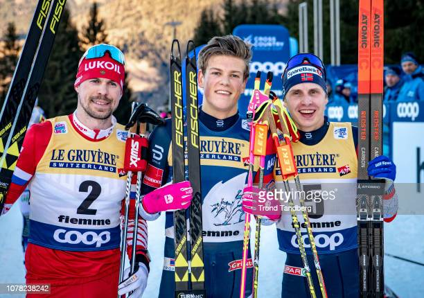 Winner Johannes Hostflot Klaebo of Norway, Sergey Ustiugov of Russia, Simen Hegstad Krueger of Norway after Tour de Ski Men 9.0 km Pursuit Free -...