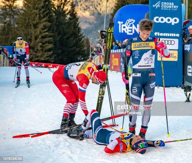 Winner Johannes Hostflot Klaebo of Norway, Sergey Ustiugov of Russia, Simen Hegstad Krueger of Norway, Sjur Goethe of Norway after Tour de Ski Men...