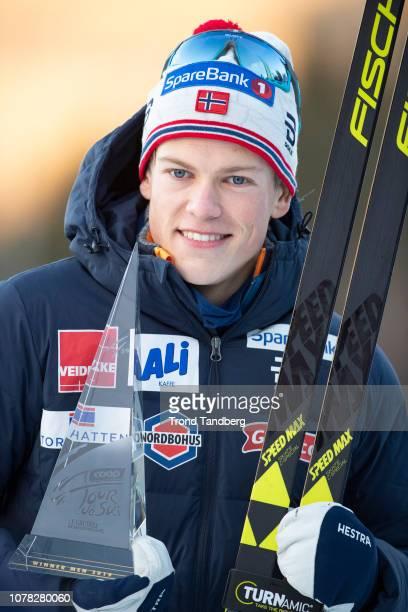 Winner Johannes Hostflot Klaebo of Norway show the Trophy after Tour de Ski Men 9.0 km Pursuit Free - Final Climb on January 6, 2019 in Val di...