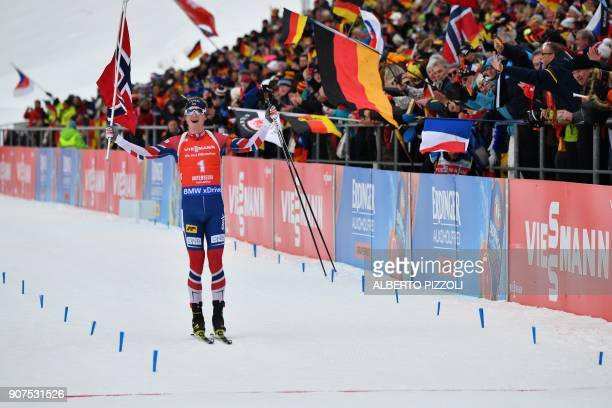 Winner Johannes Thingnes Boe of Norway celebrates as he crosses the finish line of the Men's 125 km Pursuit Competition of the IBU World Cup Biathlon...