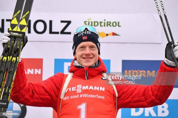 Winner Johannes Thingnes Boe of Norway celebrates on the podium of the Men's 125 km Pursuit Competition of the IBU World Cup Biathlon in Anterselva...