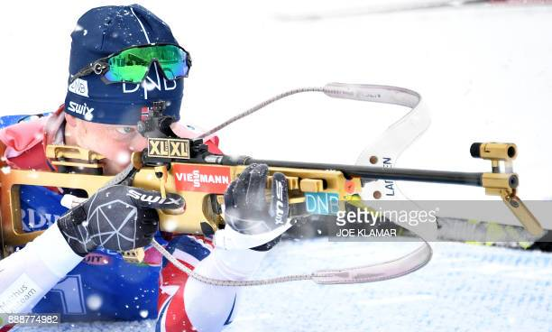 Winner Johannes Thingnes Boe of Norway competes at the shooting stand in the men's 125 km pursuit event at the IBU World Cup Biathlon in Hochfilzen...