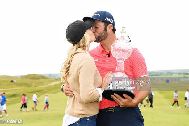 Winner Jon Rahm of Spain celebrates with girlfriend Kelley Cahill and his trophy during Day Four of the Dubai Duty Free Irish Open at Lahinch Golf...