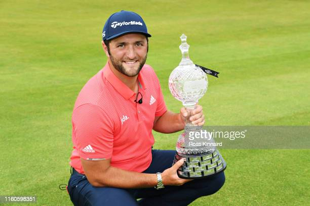 Winner Jon Rahm of Spain poses for a photo with his trophy during Day Four of the Dubai Duty Free Irish Open at Lahinch Golf Club on July 07 2019 in...