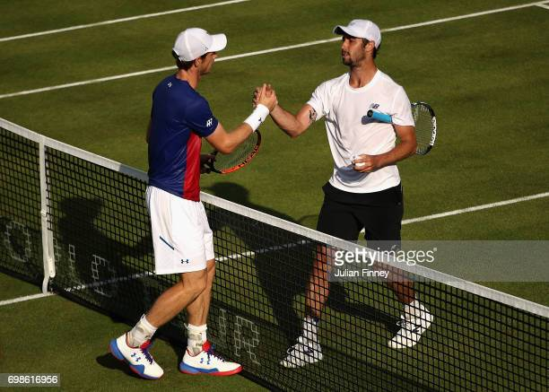 Winner Jordan Thompson of Australia speaks with runner up Andy Murray of Great Britain following their mens singles first round match on day two of...