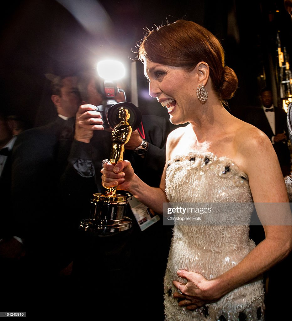 Winner Julianne Moore is seen backstage as she holds her statuette for Best Actress in a Leading Role during the 87th Annual Academy Awards at Dolby Theatre on February 22, 2015 in Hollywood, California.