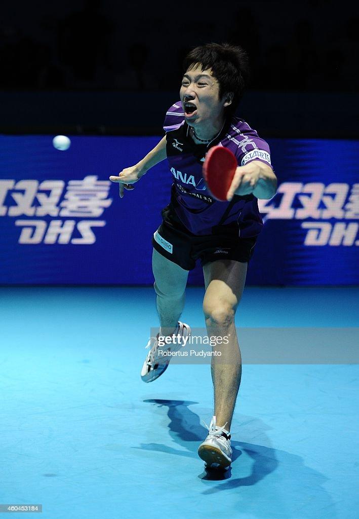 Winner Jun Mizutani of Japan in action during the Men's single final match of the 2014 ITTF World Tour Grand Finals at Huamark Indoor Stadium on December 14, 2014 in Bangkok, Thailand.