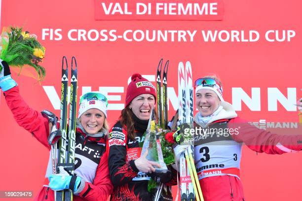Winner Justyna Kowalczyk of Poland second Therese Johaug of Norway and third Kristin Stoermer Steira of Norway celebrate on the podium of the women's...