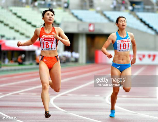 Winner Kana Ichikawa and 5th finish Chisato Fukushima react after the Women's 200m during day three of the 101st JAAF Athletics Championships at...