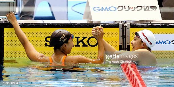 Winner Kanako Watanabe and second place Satomi Suzuki celebrate qualifying for the Rio de Janeiro Olympic Games after the Women's 100m Breaststroke...