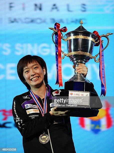Winner Kasumi Ishikawa of Japan poses with the trophy on the podium during the awarding ceremony of the 2014 ITTF World Tour Grand Finals at Huamark...