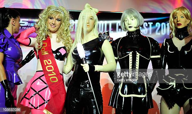 Winner Katja Lynx of the Netherlands poses with her competitors at a RubberdollContest at the Latexpo 2010 at the Edelfettwerk on August 21 2010 in...