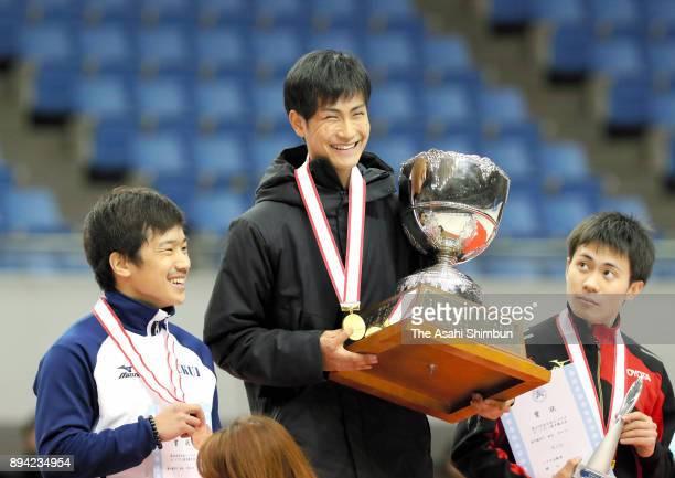Winner Kazuki Yoshinaga celebrates with runnerup Hiroki Yokoyama and thirdplaced Hijiri Iwashita on the podium for Men's Overall Championship during...