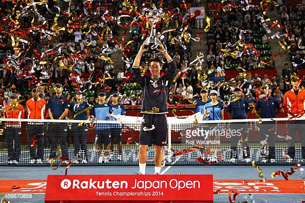 Winner Kei Nishikori of Japan celebrates with his trophy after winning the men's singles final match against Milos Raonic of Canada on day seven of...