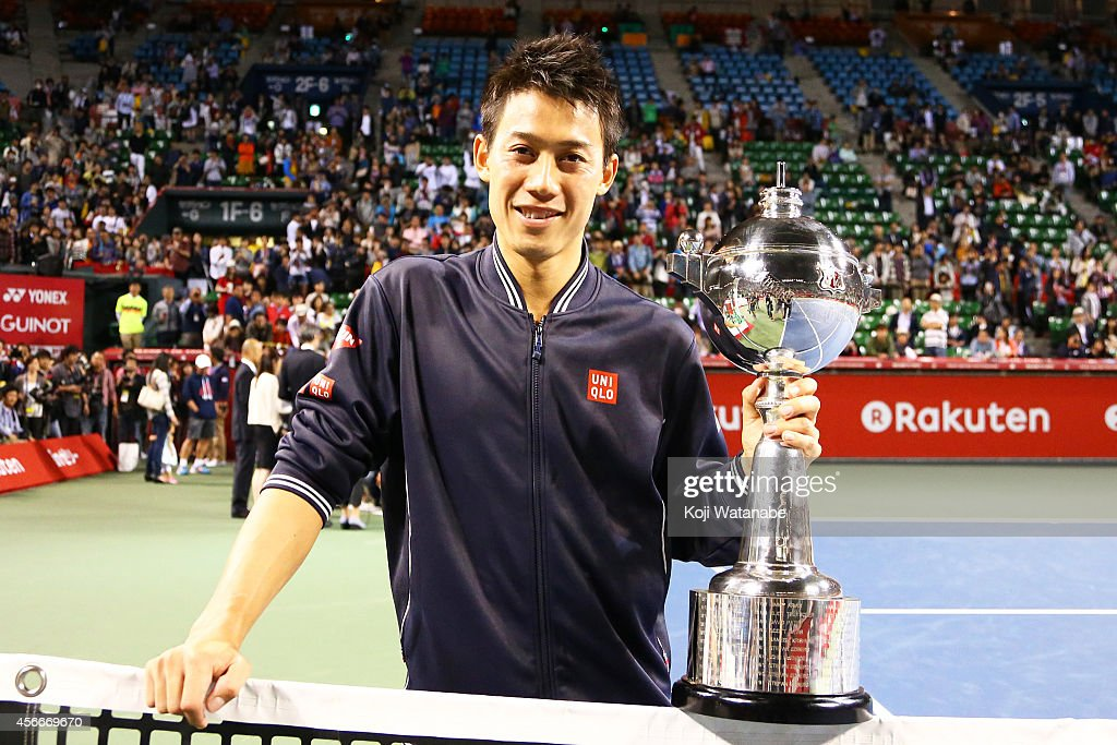 Winner Kei Nishikori of Japan poses with his trophy after winning the men's singles final match against Milos Raonic of Canada on day seven of Rakuten Open 2014 at Ariake Colosseum on October 5, 2014 in Tokyo, Japan.