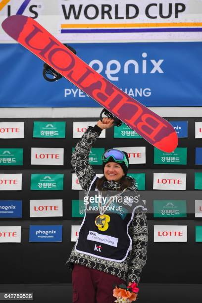 Winner Kelly Clark of the US celebrates during the award ceremony after the women's halfpipe final in the FIS Snowboard World Cup at Phoenix Snow...