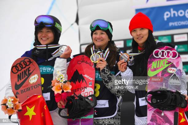 Winner Kelly Clark of the US secondplaced Liu Jiayu of China and third placed Cai Xuetong of China pose during the award ceremony after the women's...
