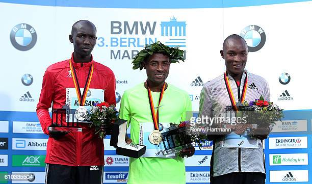 Winner Kenenisa Bekele of Ethiopia second placed Wilson Kipsang of Kenie and third placed Evans Chebet of Kenia pose during the medal ceremony after...