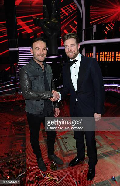 Winner Kevin Simm and coach Ricky Wilson pose at The Voice Live Final at Elstree Studios on April 9 2016 in Borehamwood England
