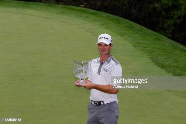 Winner Kevin Streelman accepts the Crystal Pedestal Bowl with his caddie Ethan Couch after the Par 3 Contest for the Masters at Augusta National on...
