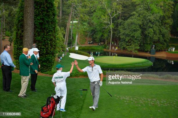 Winner Kevin Streelman highfives his caddie Ethan Couch on No 9 during the Par 3 Contest for the Masters at Augusta National on Wednesday April 8 2015
