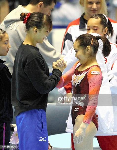 Winner Koko Tsurumi and second place Rie Tanaka shake hands after day two of the All Japan Artistic Gymnastics Championships at Yoyogi National...