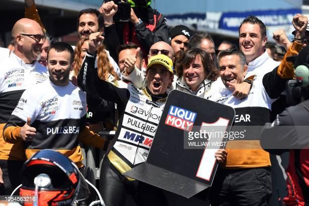 Winner KTM Angel Nieto's Spanish rider Albert Arenas celebrates teammates after the Australian Grand Prix Moto3 race at Phillip Island on October 28...