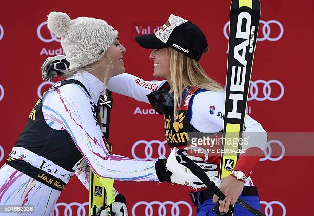 Winner Lara Gut from Switzerland embraces secondplaced Lindsey Vonn from the US during the podium ceremony after competing in the FIS Alpine World...
