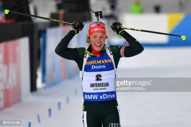 Winner Laura Dahlmeier of Germany celebrates as she crosses the finish line of the Women's 10 km Pursuit Competition of the IBU World Cup Biathlon in...