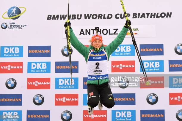Winner Laura Dahlmeier of Germany celebrates on the podium of the Women's 10 km Pursuit Competition of the IBU World Cup Biathlon in Anterselva on...
