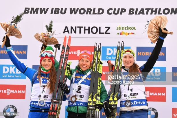 Winner Laura Dahlmeier of Germany Dorothea Wierer of Italy second and Darya Domracheva of Belarus third celebrate during the podium ceremony of the...