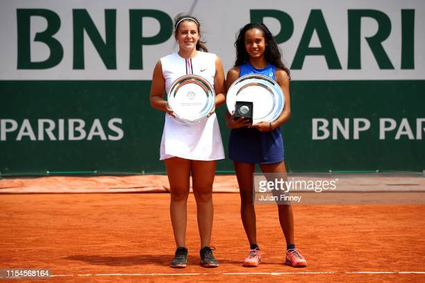 Winner Leylah Annie Fernandez of Canada and runner up Emma Navarro of The United States celebrate with their trophies during Day fourteen of the 2019...