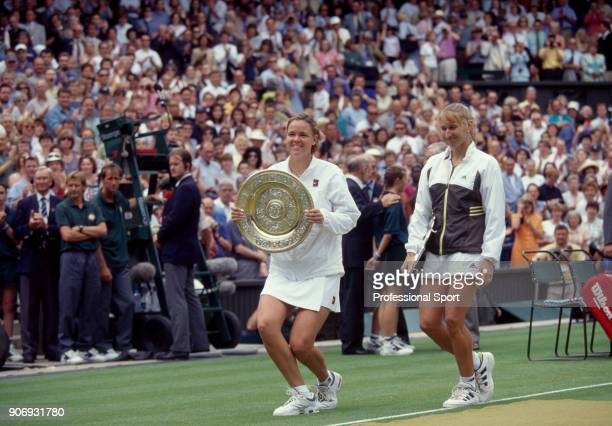 Winner Lindsay Davenport of the USA and Runnerup Steffi Graf of Germany leaving Centre Court with their trophies after the Women's Singles Final of...