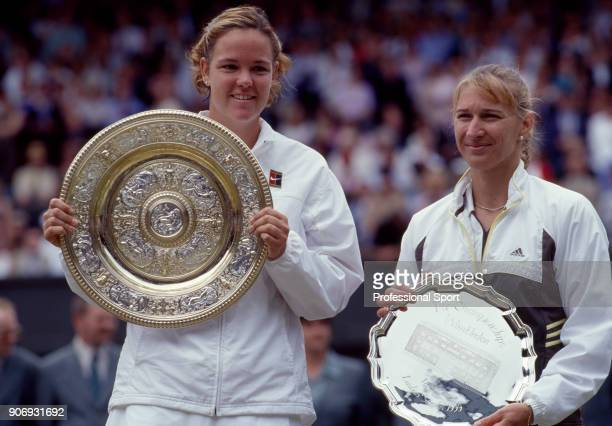 Winner Lindsay Davenport of the USA and Runnerup Steffi Graf of Germany with their trophies after the Women's Singles Final of the Wimbledon Lawn...