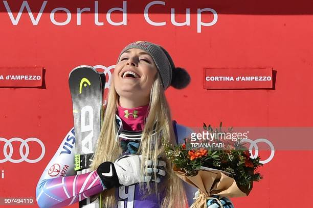 Winner Lindsey Vonn from the USA celebrates during the podium ceremony of the FIS Alpine World Cup Women's Downhill on January 20, 2018 in Cortina...