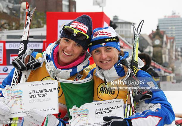 Winner Magda Genuin of Italy and Arianna Follis of Italy pose after the women's team sprint final in the FIS Cross Country World Cup on December 5...