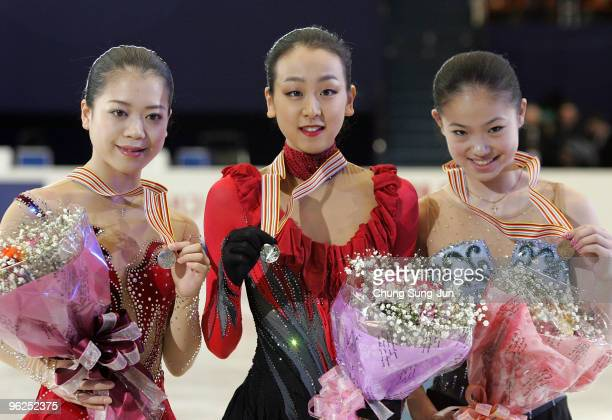 Winner Mao Asada of Japan 2nd placed Akiko Suzuki of Japan and and 3rd placed Caroline Zhang of USA stand after competing in the Ladies free program...