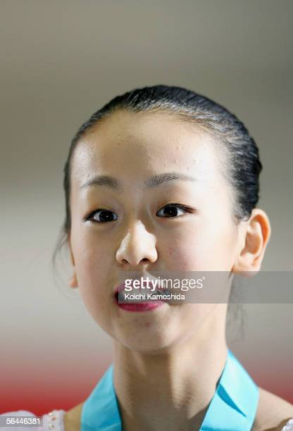 Winner Mao Asada of Japan poses for photographers after competing in the Ladies event of the Grand Prix of Figure Skating Final 2005/2006 at Yoyogi...