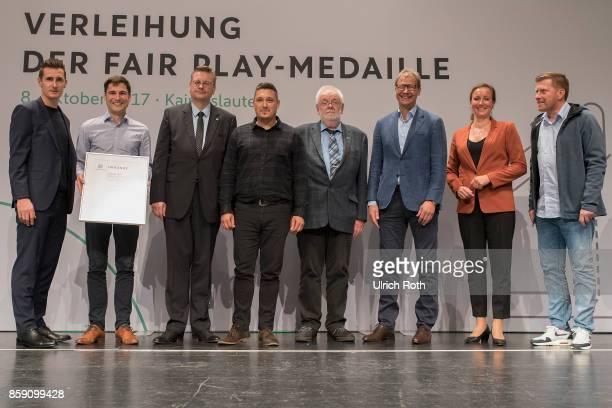 Winner Marco Sallemi and Jonte Laatz with HeinzDieter Ebeling from the national association Niedersachsen with Miroslav Klose DFB President Rheinhard...