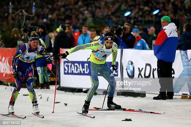 Winner Marie Dorin-Habert of France and Martin Fourcade of France change during the IKK classic Biathlon World Team Challenge 2015 at Veltins-Arena...