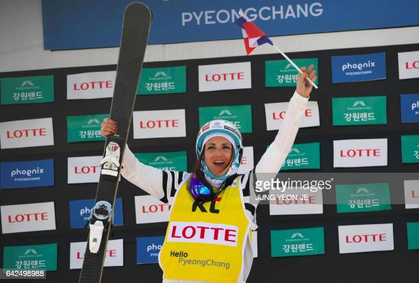 Winner Marie Martinod of France celebrates during the award ceremony after the women's Halfpipe final event of the FIS Freestyle Ski World Cup at...