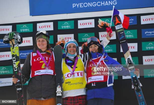 Winner Marie Martinod of France, second placed Devin Logan of the US and third placed Ayana Onozuka of Japan pose during the award ceremony after the...