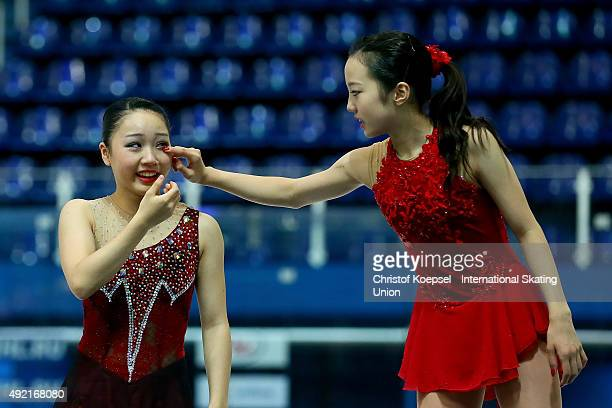 Winner Marin Honda of Japan comforts second winner Wakaba Higuchi of Japan on the podium during the medal ceremony of the junior ladies free skating...