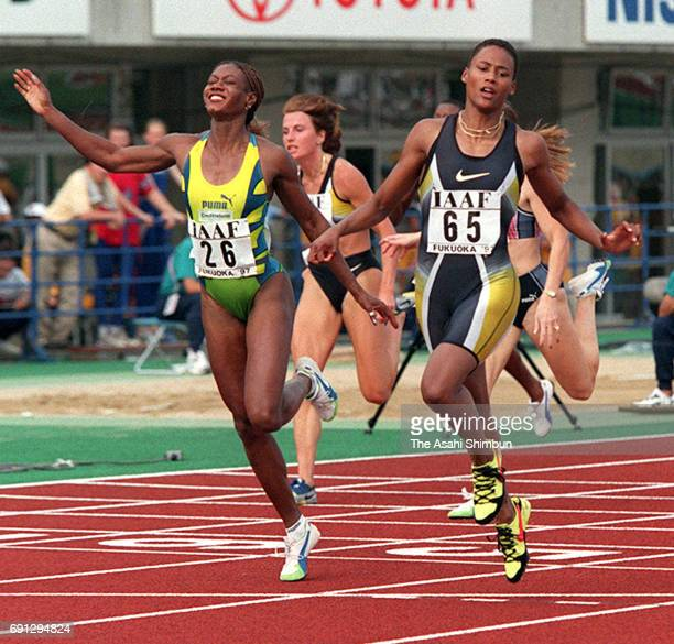 Winner Marion Jones of the United States and runner-up Merlene Ottey of Jamaica react after competing in the Women's 200m during the IAAF Frand Prix...