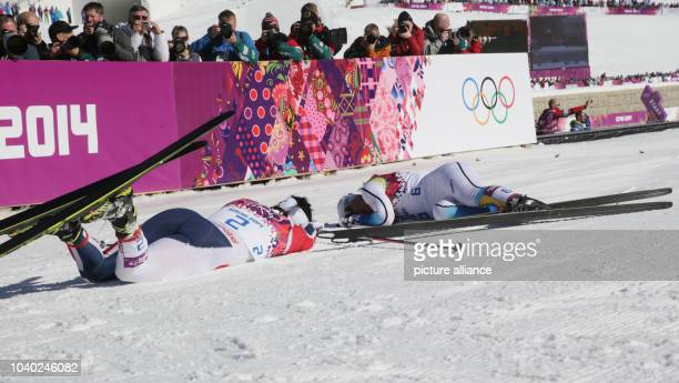 Winner Marit Bjoergen of Norway and Second placed Charlotte Kalla collapse on the snow after the Ladies' Skiathlon 75 km Classic 75 km Free in Laura...