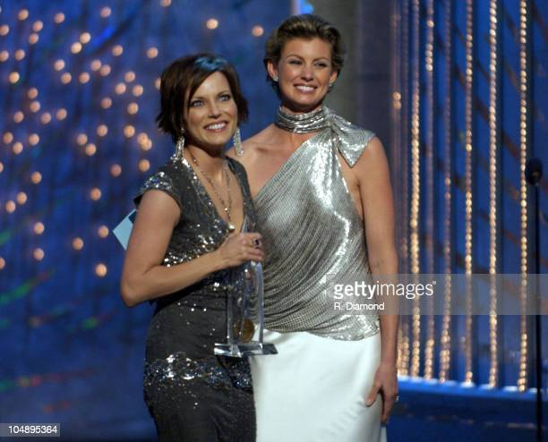 Winner Martina McBride accepts her award for Female Vocalist Of The Year from presenter Faith Hill