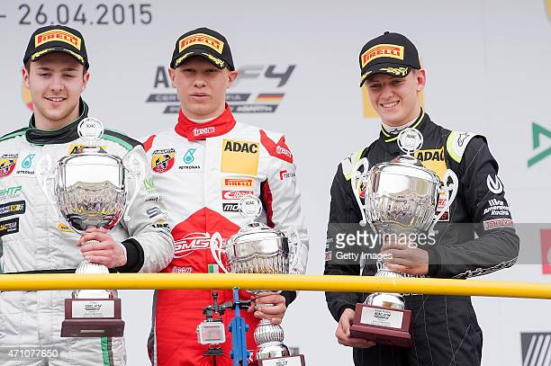 Winner Marvin Dienst celebrates on the podium with 3rd placed driver Mattia Drudi and Mick Schumacher as best rookie after the first race of the ADAC...