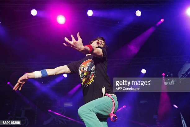 Winner Matt 'Airistotle' Burns of the USA performs during the final of the Air Guitar World Championships in Oulu Finland on August 25 2017 / AFP...